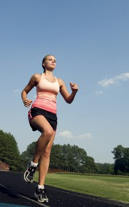 15322-a-healthy-young-woman-running-600px